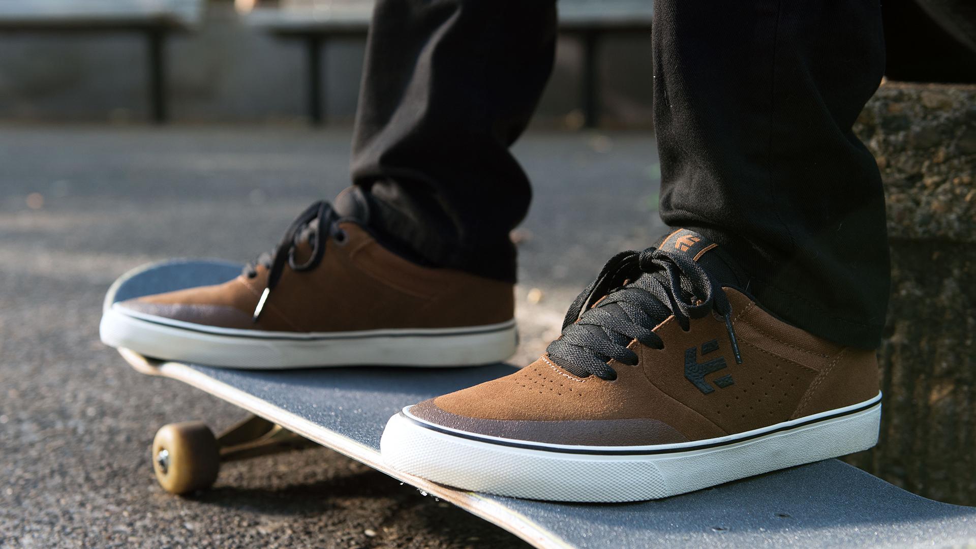 Etnies shoes on a skateboard